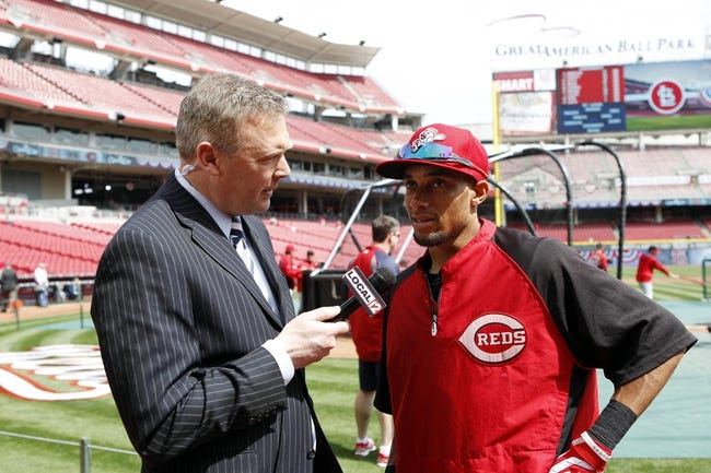 Mar 31, 2014; Cincinnati, OH, USA; Cincinnati Reds center fielder Billy Hamilton (6) is interviewed by reporter Brad Johansen prior to the game against the St. Louis Cardinals at Great American Ball Park. Mandatory Credit: Frank Victores-USA TODAY Sports