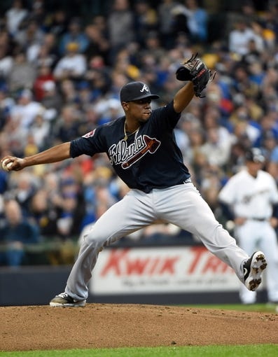 Mar 31, 2014; Milwaukee, WI, USA;   Atlanta Braves pitcher Julio Teheran (49) pitches in the first inning against the against the Milwaukee Brewers of an opening day baseball game at Miller Park. Mandatory Credit: Benny Sieu-USA TODAY Sports