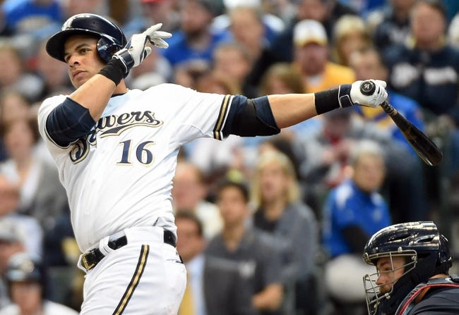 Mar 31, 2014; Milwaukee, WI, USA;   Milwaukee Brewers third baseman Aramis Ramirez (16) hits a double to drive in 2 runs in the fourth inning against the Atlanta Braves of an opening day baseball game at Miller Park. Mandatory Credit: Benny Sieu-USA TODAY Sports