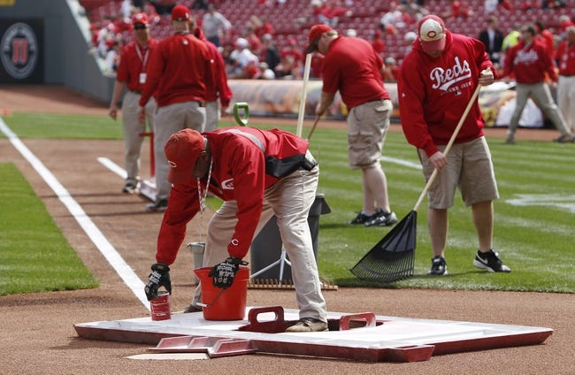 Mar 31, 2014; Cincinnati, OH, USA; Cincinnati Reds grounds keepers prepare the field prior to the game against the St. Louis Cardinals at Great American Ball Park. Mandatory Credit: Frank Victores-USA TODAY Sports