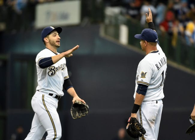 Mar 31, 2014; Milwaukee, WI, USA;   Milwaukee Brewers left fielder Ryan Braun (8) and third baseman Aramis Ramirez (16) celebrate after beating the Atlanta Braves 2-0 in an opening day baseball game at Miller Park. Mandatory Credit: Benny Sieu-USA TODAY Sports