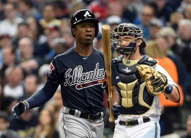 Mar 31, 2014; Milwaukee, WI, USA;   Atlanta Braves left fielder B.J. Upton (2) reacts after striking out in the third inning against the Milwaukee Brewers of an opening day baseball game at Miller Park. The Brewers beat the Braves 2-0.  Mandatory Credit: Benny Sieu-USA TODAY Sports