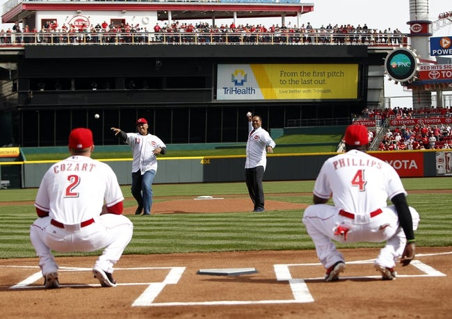 Mar 31, 2014; Cincinnati, OH, USA; Former Cincinnati Reds Barry Larkin (right) and Dave Concepcion (13) throw out the first pitch to shortstop Zack Cozart (2) and second baseman Brandon Phillips (4) prior to the game against the St. Louis Cardinals at Great American Ball Park. Mandatory Credit: Frank Victores-USA TODAY Sports