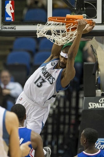 Mar 31, 2014; Minneapolis, MN, USA; Minnesota Timberwolves forward Corey Brewer (13) dunks the ball in the first half against the Los Angeles Clippers at Target Center. Mandatory Credit: Jesse Johnson-USA TODAY Sports