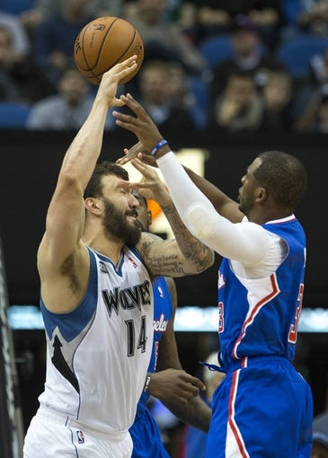 Mar 31, 2014; Minneapolis, MN, USA; Minnesota Timberwolves center Nikola Pekovic (14) and Los Angeles Clippers guard Chris Paul (3) fight for a loose ball in the first half at Target Center. Mandatory Credit: Jesse Johnson-USA TODAY Sports