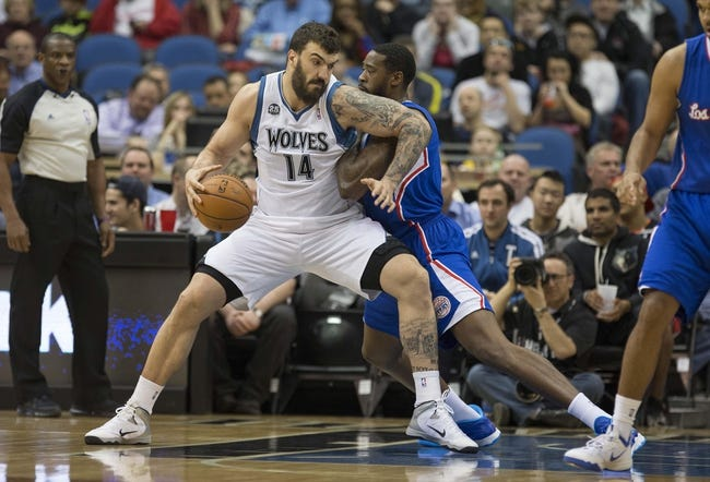 Mar 31, 2014; Minneapolis, MN, USA; Minnesota Timberwolves center Nikola Pekovic (14) drives to the basket against Los Angeles Clippers center DeAndre Jordan (6) in the first half at Target Center. Mandatory Credit: Jesse Johnson-USA TODAY Sports