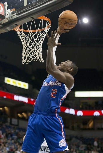 Mar 31, 2014; Minneapolis, MN, USA; Los Angeles Clippers guard Darren Collison (2) goes up for a layup against the Minnesota Timberwolves in the first half at Target Center. Mandatory Credit: Jesse Johnson-USA TODAY Sports