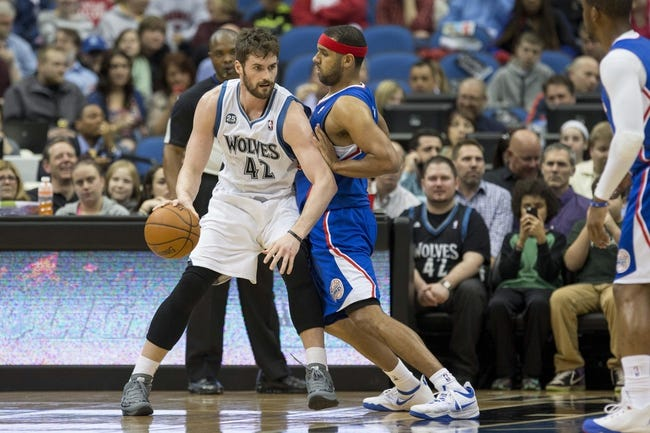 Mar 31, 2014; Minneapolis, MN, USA; Minnesota Timberwolves forward Kevin Love (42) attempts to get around Los Angeles Clippers forward Jared Dudley (9) in the first half at Target Center. Mandatory Credit: Jesse Johnson-USA TODAY Sports