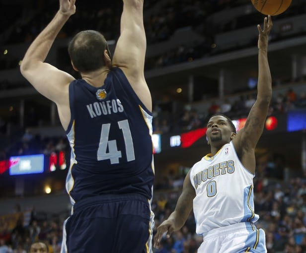 Mar 31, 2014; Denver, CO, USA; Denver Nuggets guard Aaron Brooks (0) shoots the ball during the first half against the Memphis Grizzlies at Pepsi Center. Mandatory Credit: Chris Humphreys-USA TODAY Sports