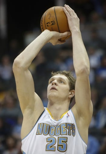 Mar 31, 2014; Denver, CO, USA; Denver Nuggets center Timofey Mozgov (25) shoots the ball during the first half against the Memphis Grizzlies at Pepsi Center. Mandatory Credit: Chris Humphreys-USA TODAY Sports