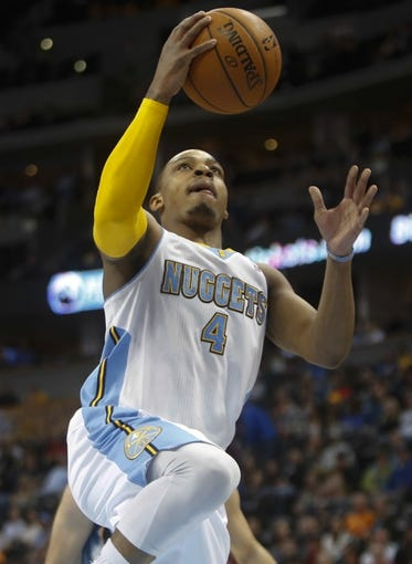 Mar 31, 2014; Denver, CO, USA; Denver Nuggets guard Randy Foye (4) shoots the ball during the first half against the Memphis Grizzlies at Pepsi Center. Mandatory Credit: Chris Humphreys-USA TODAY Sports