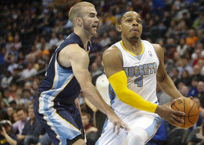 Mar 31, 2014; Denver, CO, USA; Denver Nuggets guard Randy Foye (4) drives to the basket during the first half against the Memphis Grizzlies at Pepsi Center. Mandatory Credit: Chris Humphreys-USA TODAY Sports