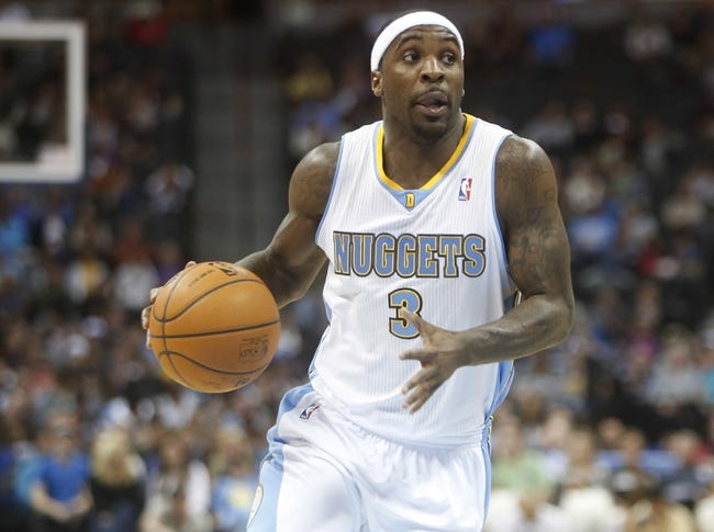 Mar 31, 2014; Denver, CO, USA; Denver Nuggets guard Ty Lawson (3) drives to the basket during the first half against the Memphis Grizzlies at Pepsi Center. Mandatory Credit: Chris Humphreys-USA TODAY Sports