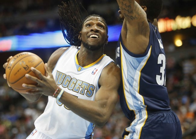 Mar 31, 2014; Denver, CO, USA; Denver Nuggets forward Kenneth Faried (35) drives to the basket during the first half against the Memphis Grizzlies at Pepsi Center. Mandatory Credit: Chris Humphreys-USA TODAY Sports