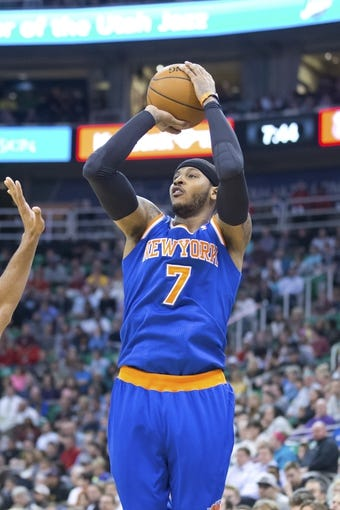 Mar 31, 2014; Salt Lake City, UT, USA; New York Knicks forward Carmelo Anthony (7) shoots during the first half against the Utah Jazz at EnergySolutions Arena. Mandatory Credit: Russ Isabella-USA TODAY Sports