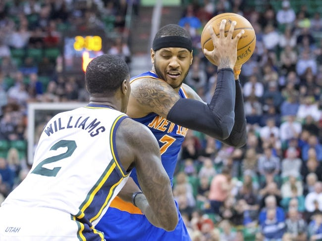 Mar 31, 2014; Salt Lake City, UT, USA; Utah Jazz forward Marvin Williams (2) defends against New York Knicks forward Carmelo Anthony (7) during the first half at EnergySolutions Arena. Mandatory Credit: Russ Isabella-USA TODAY Sports