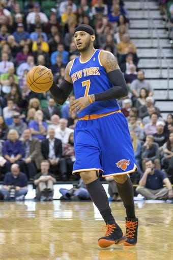 Mar 31, 2014; Salt Lake City, UT, USA; New York Knicks forward Carmelo Anthony (7) dribbles up the court during the first half against the Utah Jazz at EnergySolutions Arena. Mandatory Credit: Russ Isabella-USA TODAY Sports