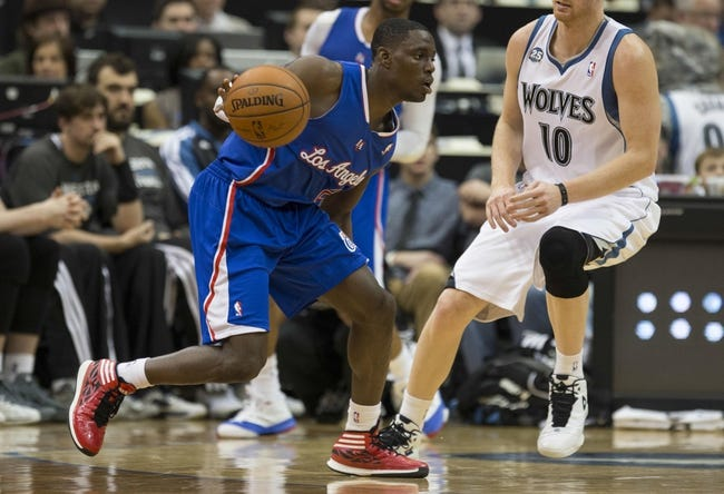 Mar 31, 2014; Minneapolis, MN, USA; Los Angeles Clippers guard Darren Collison (2) dribbles the ball in the second half against the Minnesota Timberwolves at Target Center. The Clippers won 114-104. Mandatory Credit: Jesse Johnson-USA TODAY Sports