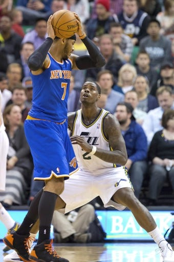 Mar 31, 2014; Salt Lake City, UT, USA; Utah Jazz forward Marvin Williams (2) defends against New York Knicks forward Carmelo Anthony (7) during the second half at EnergySolutions Arena. The Knicks won 92-83. Mandatory Credit: Russ Isabella-USA TODAY Sports