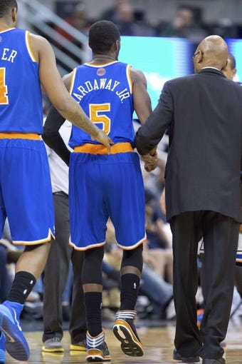Mar 31, 2014; Salt Lake City, UT, USA; New York Knicks guard Tim Hardaway Jr. (5) is helped from the court after being injured during the second half against the Utah Jazz at EnergySolutions Arena. The Knicks won 92-83. Mandatory Credit: Russ Isabella-USA TODAY Sports