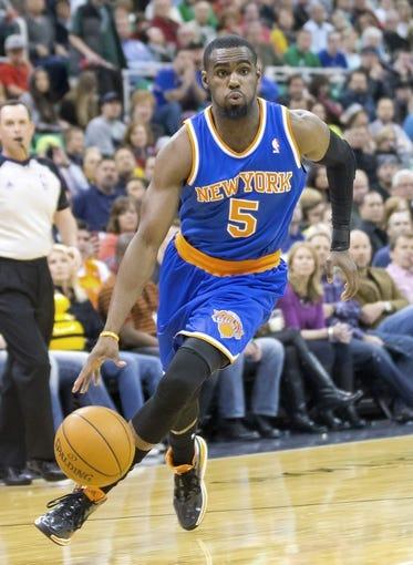 Mar 31, 2014; Salt Lake City, UT, USA; New York Knicks guard Tim Hardaway Jr. (5) dribbles the ball during the first half against the Utah Jazz at EnergySolutions Arena. The Knicks won 92-83. Mandatory Credit: Russ Isabella-USA TODAY Sports