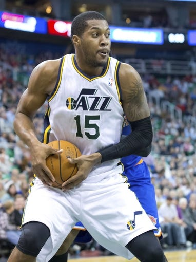 Mar 31, 2014; Salt Lake City, UT, USA; Utah Jazz center Derrick Favors (15) controls the ball during the second half against the New York Knicks at EnergySolutions Arena. The Knicks won 92-83. Mandatory Credit: Russ Isabella-USA TODAY Sports