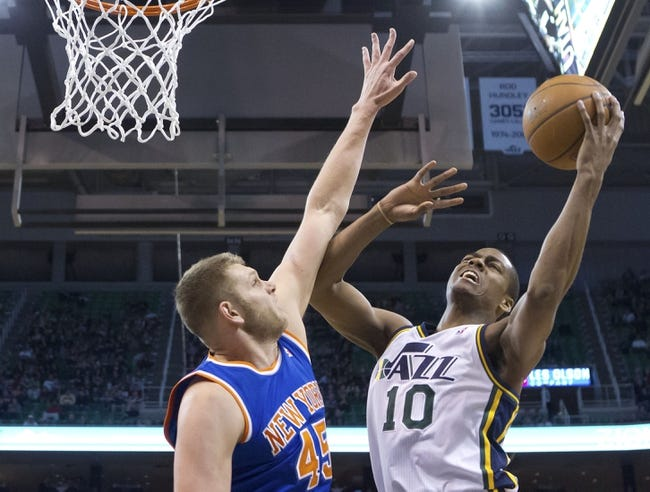 Mar 31, 2014; Salt Lake City, UT, USA; Utah Jazz guard Alec Burks (10) goes up for a shot against New York Knicks center Cole Aldrich (45) during the first half at EnergySolutions Arena. The Knicks won 92-83. Mandatory Credit: Russ Isabella-USA TODAY Sports