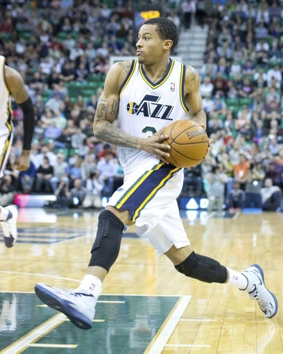 Mar 31, 2014; Salt Lake City, UT, USA; Utah Jazz guard Trey Burke (3) drives to the basket during the second half against the New York Knicks at EnergySolutions Arena. The Knicks won 92-83. Mandatory Credit: Russ Isabella-USA TODAY Sports