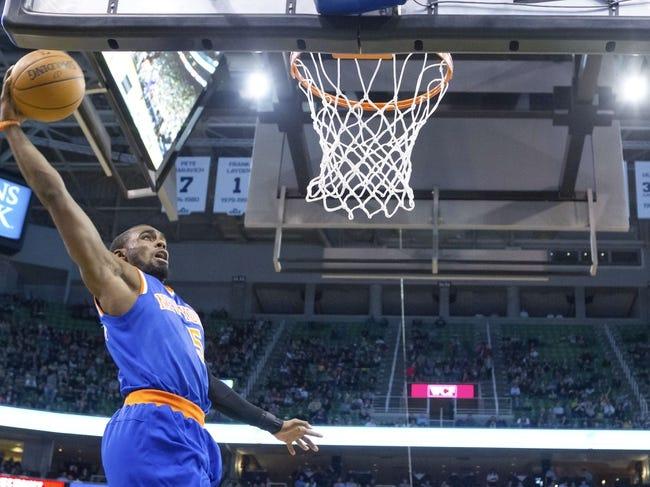 Mar 31, 2014; Salt Lake City, UT, USA; New York Knicks guard Tim Hardaway Jr. (5) dunks during the second half against the Utah Jazz at EnergySolutions Arena. The Knicks won 92-83. Mandatory Credit: Russ Isabella-USA TODAY Sports