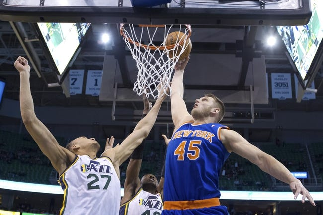 Mar 31, 2014; Salt Lake City, UT, USA; New York Knicks center Cole Aldrich (45) goes up for a shot against Utah Jazz center Rudy Gobert (27) during the second half at EnergySolutions Arena. The Knicks won 92-83. Mandatory Credit: Russ Isabella-USA TODAY Sports