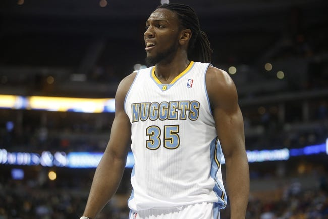Mar 31, 2014; Denver, CO, USA; Denver Nuggets forward Kenneth Faried (35) reacts on the court during the second half against the Memphis Grizzlies  at Pepsi Center.  The Grizzlies won 94-92.  Mandatory Credit: Chris Humphreys-USA TODAY Sports