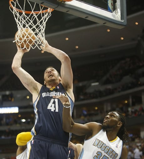 Mar 31, 2014; Denver, CO, USA; Memphis Grizzlies center Kosta Koufos (41) shoots the ball during the second half against the Denver Nuggets at Pepsi Center.  The Grizzlies won 94-92.  Mandatory Credit: Chris Humphreys-USA TODAY Sports