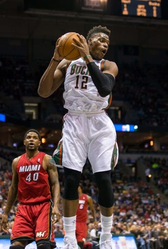 Mar 29, 2014; Milwaukee, WI, USA; Milwaukee Bucks forward Jeff Adrien (12) during the game against the Miami Heat at BMO Harris Bradley Center.  Miami won 88-67.  Mandatory Credit: Jeff Hanisch-USA TODAY Sports