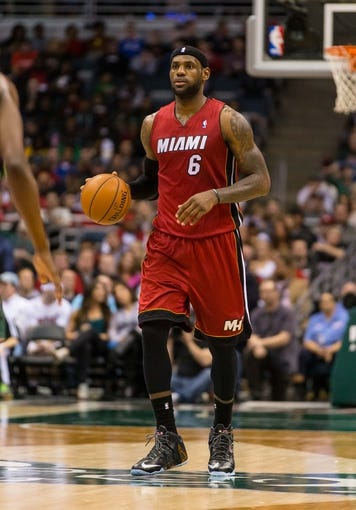 Mar 29, 2014; Milwaukee, WI, USA; Miami Heat forward LeBron James (6) during the game against the Milwaukee Bucks at BMO Harris Bradley Center.  Miami won 88-67.  Mandatory Credit: Jeff Hanisch-USA TODAY Sports