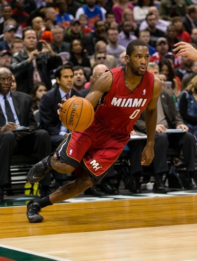 Mar 29, 2014; Milwaukee, WI, USA; Miami Heat guard Toney Douglas (0) during the game against the Milwaukee Bucks at BMO Harris Bradley Center.  Miami won 88-67.  Mandatory Credit: Jeff Hanisch-USA TODAY Sports