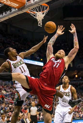 Mar 29, 2014; Milwaukee, WI, USA; Milwaukee Bucks guard Brandon Knight (11) blocks Miami Heat forward Chris Andersen (11) during the game at BMO Harris Bradley Center.  Miami won 88-67.  Mandatory Credit: Jeff Hanisch-USA TODAY Sports