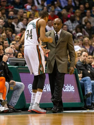 Mar 29, 2014; Milwaukee, WI, USA; Milwaukee Bucks head coach Larry Drew talks with guard Giannis Antetokounmpo (34) during the game against the Miami Heat at BMO Harris Bradley Center.  Miami won 88-67.  Mandatory Credit: Jeff Hanisch-USA TODAY Sports