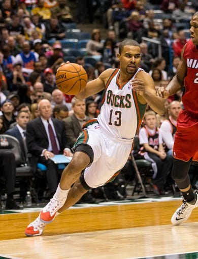 Mar 29, 2014; Milwaukee, WI, USA; Milwaukee Bucks guard Ramon Sessions (13) during the game against the Miami Heat at BMO Harris Bradley Center.  Miami won 88-67.  Mandatory Credit: Jeff Hanisch-USA TODAY Sports