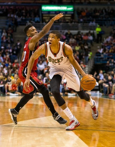 Mar 29, 2014; Milwaukee, WI, USA; Milwaukee Bucks guard Giannis Antetokounmpo (34) during the game against the Miami Heat at BMO Harris Bradley Center.  Miami won 88-67.  Mandatory Credit: Jeff Hanisch-USA TODAY Sports