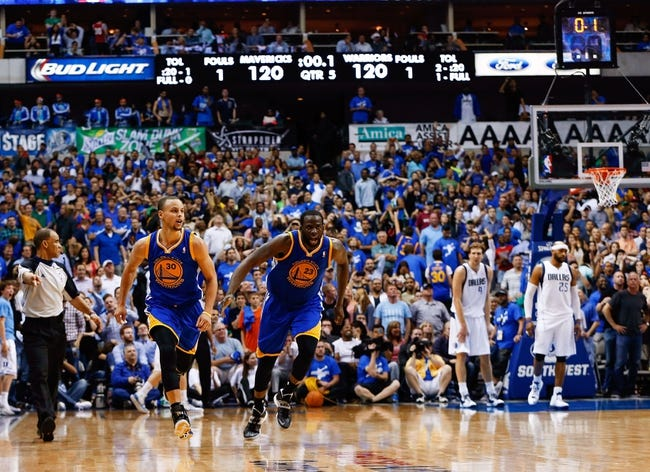 Apr 1, 2014; Dallas, TX, USA; Golden State Warriors guard Stephen Curry (30) and forward Draymond Green (23) react after Curry hit the game winning shot in overtime against the Dallas Mavericks at American Airlines Center. Mandatory Credit: Kevin Jairaj-USA TODAY Sports