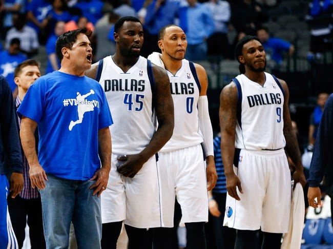 Apr 1, 2014; Dallas, TX, USA; Dallas Mavericks owner Mark Cuban (far left) comes onto the court and yells at officials during overtime against the Golden State Warriors at American Airlines Center. Mandatory Credit: Kevin Jairaj-USA TODAY Sports