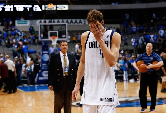 Apr 1, 2014; Dallas, TX, USA; Dallas Mavericks forward Dirk Nowitzki (41) reacts after the loss against the Golden State Warriors at American Airlines Center. Mandatory Credit: Kevin Jairaj-USA TODAY Sports