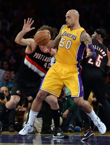 Apr 1, 2014; Los Angeles, CA, USA;  Portland Trail Blazers center Robin Lopez (42) guards Los Angeles Lakers center Robert Sacre (50) during the first half of the game at Staples Center. Mandatory Credit: Jayne Kamin-Oncea-USA TODAY Sports