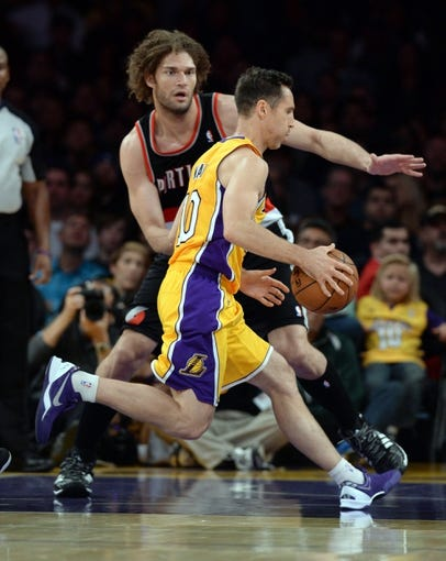 Apr 1, 2014; Los Angeles, CA, USA;  Portland Trail Blazers center Robin Lopez (42) guards Los Angeles Lakers guard Steve Nash (10) during the first half of the game at Staples Center. Mandatory Credit: Jayne Kamin-Oncea-USA TODAY Sports