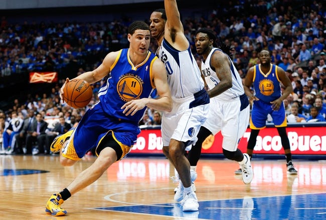 Apr 1, 2014; Dallas, TX, USA; Golden State Warriors guard Klay Thompson (11) drives to the basket against Dallas Mavericks guard Devin Harris (20) during the game at American Airlines Center. Golden State won 122-120. Mandatory Credit: Kevin Jairaj-USA TODAY Sports