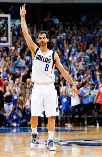 Apr 1, 2014; Dallas, TX, USA; Dallas Mavericks guard Jose Calderon (8) reacts after scoring during the game against the Golden State Warriors at American Airlines Center. Golden State won 122-120. Mandatory Credit: Kevin Jairaj-USA TODAY Sports