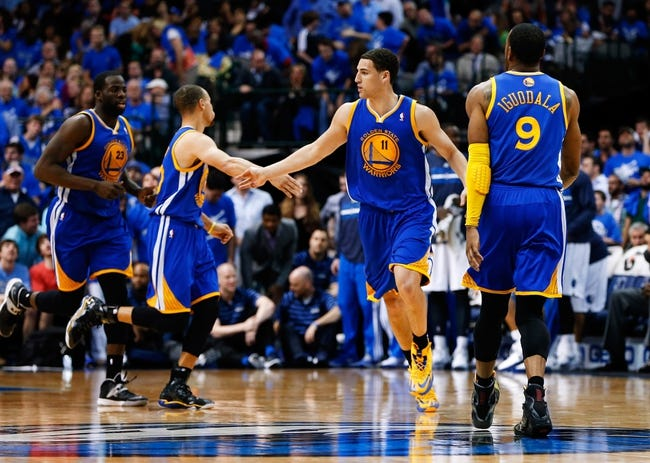Apr 1, 2014; Dallas, TX, USA; Golden State Warriors guard Klay Thompson (11) reacts during the game against the Dallas Mavericks at American Airlines Center. Golden State won 122-120. Mandatory Credit: Kevin Jairaj-USA TODAY Sports