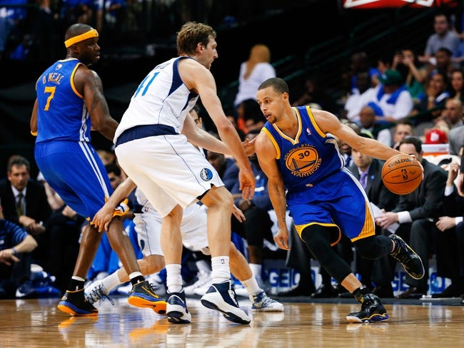 Apr 1, 2014; Dallas, TX, USA; Golden State Warriors guard Stephen Curry (30) drives to the basket around Dallas Mavericks forward Dirk Nowitzki (41) during the game at American Airlines Center. Golden State won 122-120. Mandatory Credit: Kevin Jairaj-USA TODAY Sports