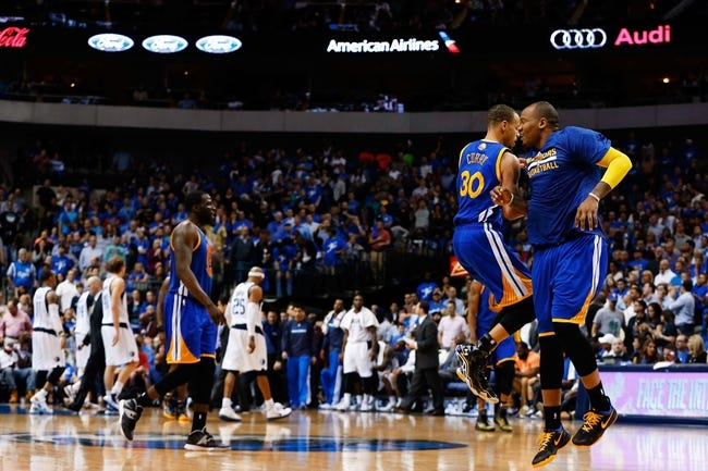 Apr 1, 2014; Dallas, TX, USA; Golden State Warriors guard Stephen Curry (30) reacts after scoring during the game against the Dallas Mavericks at American Airlines Center. Golden State won 122-120. Mandatory Credit: Kevin Jairaj-USA TODAY Sports