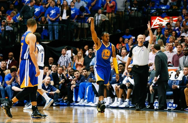 Apr 1, 2014; Dallas, TX, USA; Golden State Warriors forward Andre Iguodala (9) reacts after scoring during the game against the Dallas Mavericks at American Airlines Center. Golden State won 122-120. Mandatory Credit: Kevin Jairaj-USA TODAY Sports